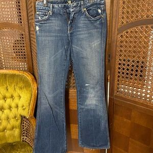 Distressed seven jeans